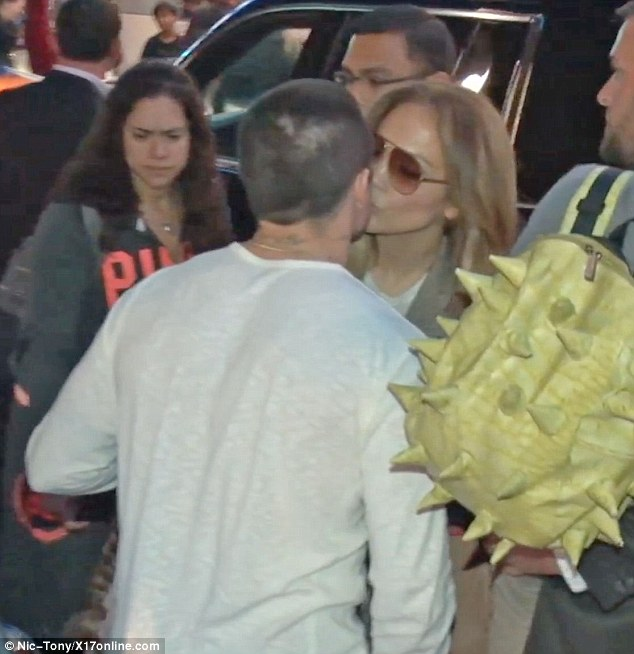 A kiss before I go: Jennifer Lopez and Casper Smart shared a sweet moment as he dropped her off at LAX following the American Idol finale