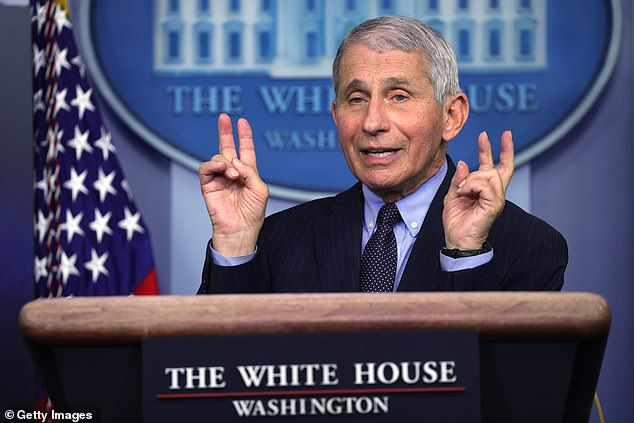 Dr Anthony Fauci said during a Thursday White House briefing that he was 'knocked out' for a full day by fatigue, chills and aches after getting his second dose of Moderna's COVID-19 vaccine on January 19